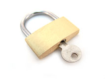 Brass padlock with key - locked Stock Images