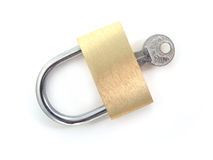 Brass padlock with key - locked Stock Photos