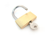 Brass padlock with key - unlocked Royalty Free Stock Image
