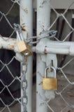 Brass padlock and metal door Stock Photo