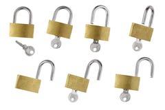 Brass Padlock and sliver Key Stock Photos