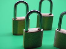 Brass padlocks. Closeup on green background Royalty Free Stock Images