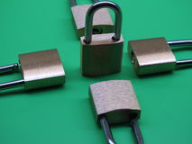Brass padlocks. Closeup on green background Stock Photos