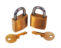 Brass Padlocks with keys. On white background Stock Photos