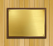 Brass Plaque. Vector image of a brass plaque mounted on dark wood sitting upon a pine wood panel background vector illustration