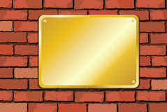 Brass plaque on brick wall Royalty Free Stock Photography