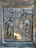 Brass Plaque on the Charles Bridge, Prague, Czech Republic. A brass plaque, an armoured knight and his faithful dog, on the Charles Bridge, Prague, Czech stock images