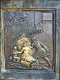 Brass Plaque on the Charles Bridge, Prague, Czech Republic. An historic brass plaque on the Charles Bridge, Prague, Czech Republic. The female and child figures royalty free stock image