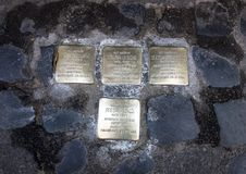 Brass plaques memorializing the death of a deported Jew. Pictured are brass plaques in the Old Jewish Ghetto in Rome, Italy memorializing the death of a deported Royalty Free Stock Images