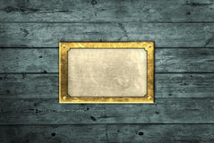 Brass plate on blue boards. An oblong brass plate on old blue wooden boards Stock Photo