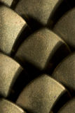 Brass plate extreme closeup. Extreme closeup of brass plate chain mail Stock Photo