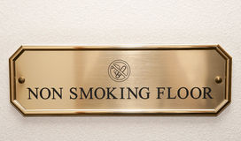 Brass plate restricting smoking on hotel floor Stock Photo