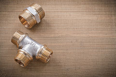 Brass plumber fixtures pipe fittings on water mesh filter Royalty Free Stock Photo