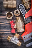 Brass plumbing equipment on wooden board directly above Royalty Free Stock Image