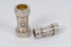 Brass plumbing fittings. Stock Images