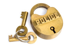 Brass police block with 2 keys. Royalty Free Stock Image