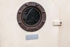 Brass porthole - ferry window frame Stock Photos