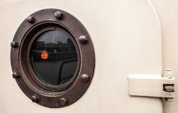 Brass porthole - ferry window frame Stock Photo