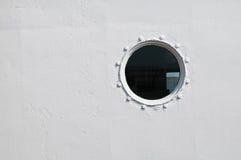 Brass porthole Stock Images