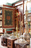 Brass pot display. A shop display of traditional metal ornamental  coffee pots and inlaid tables in an arcade in Souq Waqif, Doha, Qatar Stock Photography
