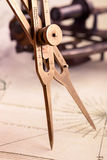 Brass proportional divider. On old map closeup shot Royalty Free Stock Photos