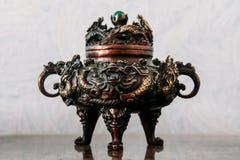 Dragon turtle statuette. Brass ragon turtle statuette. Shallow depth of field Stock Photo