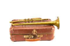 Brass retro wind instrument trumpet on old case Stock Images