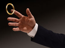 Brass Ring. Business man's hand reaching for the brass ring Royalty Free Stock Photos