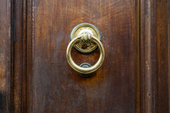 Brass ring knocker on old wooden door in Florence Stock Photos