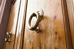 Brass ring knocker on old wooden door Royalty Free Stock Image