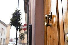 Brass ring knocker on old wooden door Stock Photos