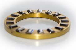 Brass roller cage of a thrust roller bearing. With selective focus Royalty Free Stock Image