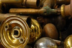 Brass Salvage objects. Background comprised of antique brass objects including taps and door knobs Stock Photography