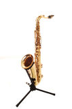 An brass saxophone on the stand. Royalty Free Stock Photos