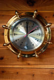 Brass Ship Clock. Close Up of Brass Ship's Clock Against Red Cedar Planking, 2 O'Clock, 14 Hundred Hours Stock Image