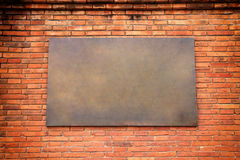 Brass sign on brick wall  background. Stock Images