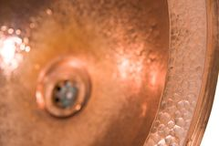 Detail of copper round sink. Brown copper sink in retro style. Antique sink for home. Macro shooting. Brass sink in retro style. Antique sink for home on white royalty free stock photos