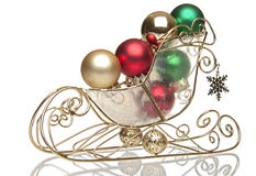 Brass Sleigh with Christmas balls Royalty Free Stock Images