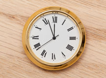 Brass small watch or clock on wood table Royalty Free Stock Photography