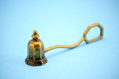 Brass sniffer bell for extinguishing candle Royalty Free Stock Photo