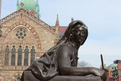 Brass statue in copley square. Brass statue of woman with old south church in background Stock Photography