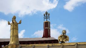 Brass statue on the roof with sky. On the building Stock Photo