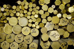 BRASS STORAGE. Several bars of brass in storage stock images