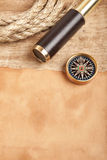 Brass telescope and compass Royalty Free Stock Photography