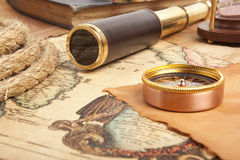 Brass telescope on map. Vintage brass telescope on antique map Stock Image