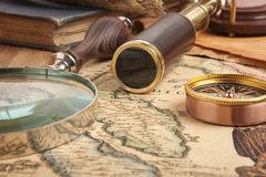 Brass telescope on map. Vintage brass telescope on antique map Royalty Free Stock Photography