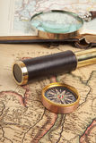 Brass telescope on map. Vintage brass telescope on antique map Stock Photo