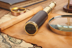 Brass telescope on map Stock Images