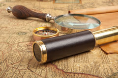 Brass telescope on map Royalty Free Stock Image