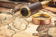 Brass telescope on map Stock Photos